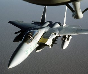 A Royal Saudi Air Force F-15 Eagle fighter aircraft approaches a KC-135 Stratotanker from the 1700th Air Refueling Squadron Provisional for refueling during Operation Desert Shield.